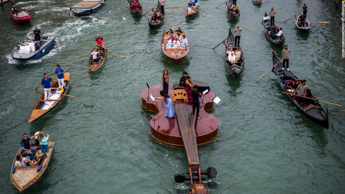 Watch: String quartet performs Vivaldi on giant violin-shaped boat