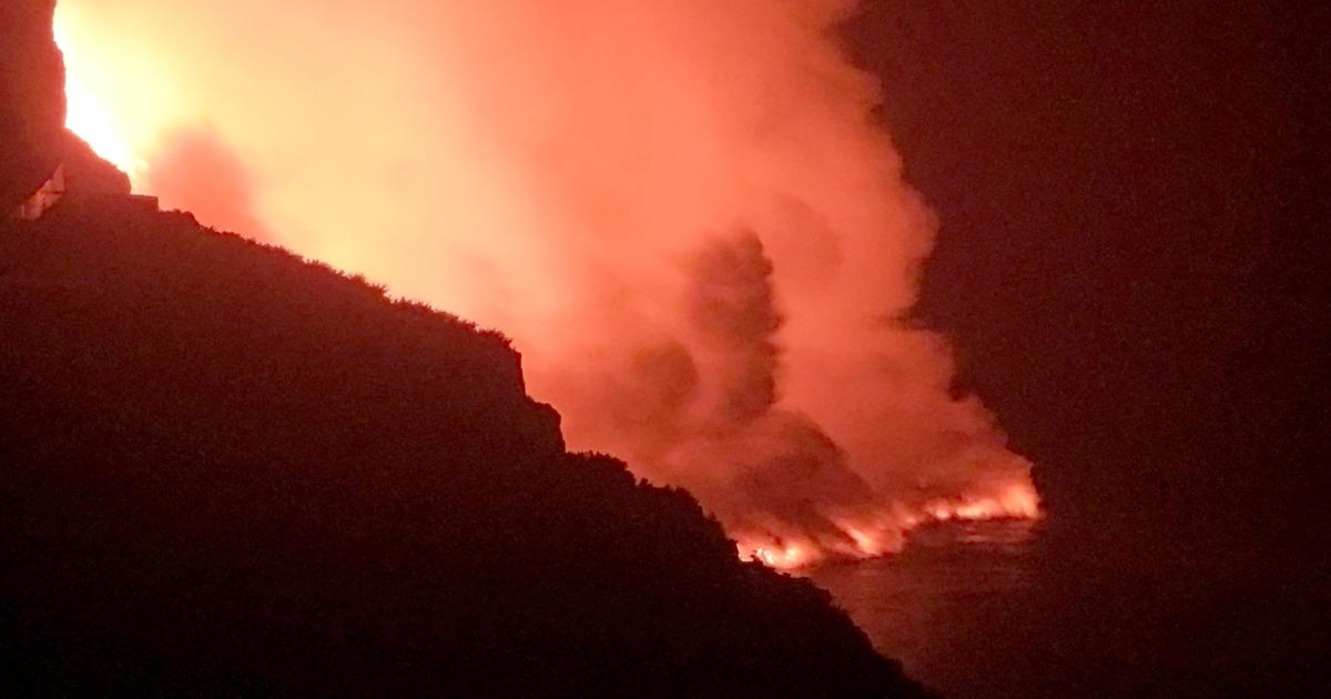Spanish island residents warned to stay indoors as lava from volcano finally hits the sea